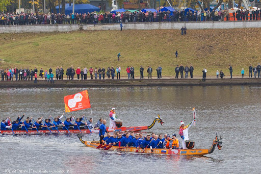 The olympic flame in a dragonboat